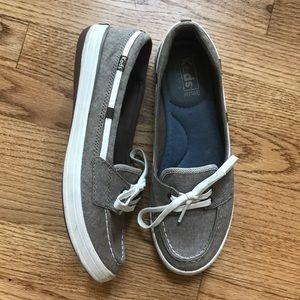 Keds slip on boat shoes.